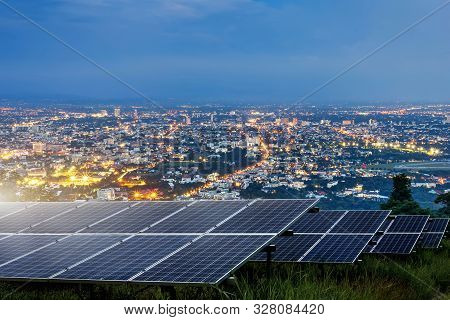 Solar Panel With City Night Architecture Electric Energy Light Background,clean Alternative Power En
