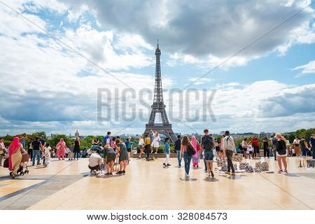 PARIS, FRANCE - July 31, 2019: Eiffel Tower is a wrought-iron lattice tower on the Champ de Mars in Paris, France.