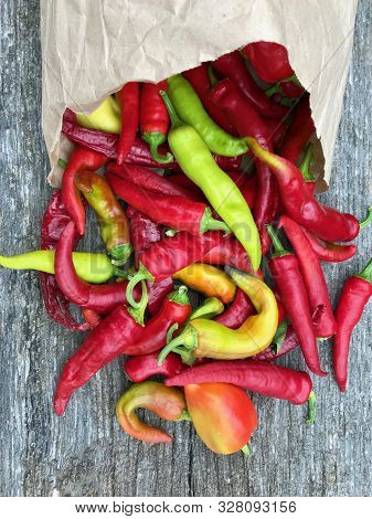 Photo On Theme Long Red Hot Chili Pepper, Acute Vegetable. Photography Consists Of Curved Red Hot Ch