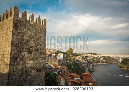 Landscape View At Bridge Ponte Do Infante On Douro River And Tower Of Castle Muralla Fernandina In P