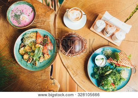 Vegan And Vegetarian Food. Variety Of Dishes On A Wooden Table, Top View, Flat Lay, Kitchen Items.