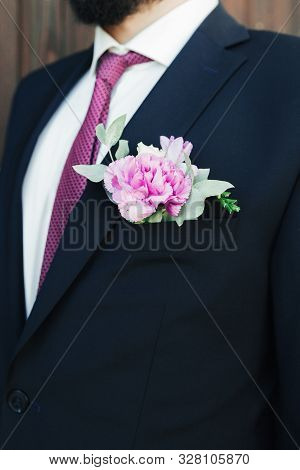 Man In A Suit And Bow-tie Close Up. On The Jacket - Buttonhole, Boutonniere. Suit Of The Groom In A
