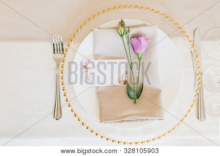 Wedding Table Setting. Transparent Plate With Fresh Flowers.