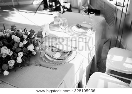 Flower Table Decorations For Holidays And Wedding Dinner. Table Set For An Restaurant. Black And Whi