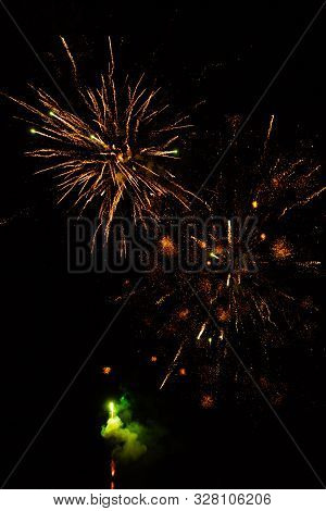 Fireworks Light Up The Sky With Dazzling Display. Colorful Fireworks On The Night Sky Background.