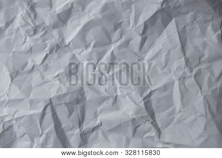 Wrinled Up White Sheet Of Paper With Creases And Folds Background