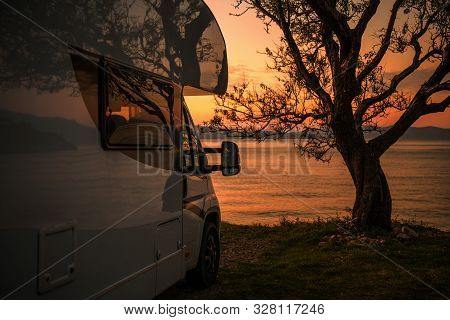 Recreational Vehicle Camper Van Rv Park Site Scenic Sea Front Sunset. Motorhome Road Trip.