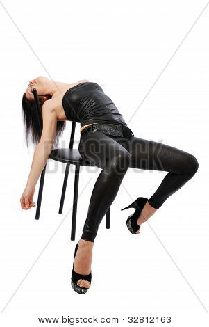Sexy Woman Lying On The Chair.