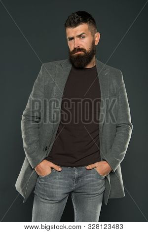 Bearded And Barbate. Bearded Man Keeping Arms In Pockets On Grey Background. Bearded Hipster In Casu