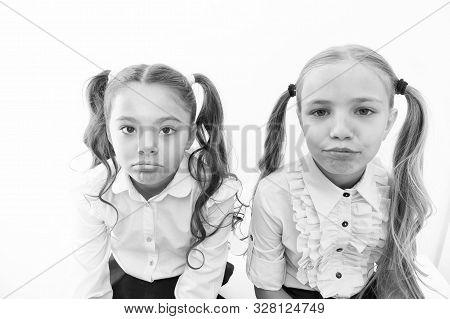 Unhappy Cuties. Unhappy Little Schoolchildren Isolated On White. Adorable Small Girls With Unhappy E