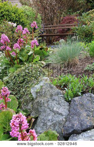 Spring flower garden and bench.