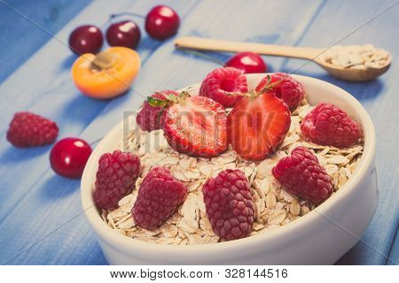 Vintage Photo. Fresh Prepared Oat Flakes And Oatmeal With Fruits, Concept Of Diet, Healthy Lifestyle