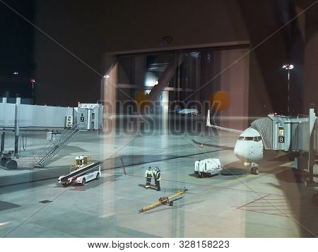 Platov Airport, Rostov-on-don, Russia - May 2019. Airport Employees, Jetways And Aircrafts On The Ai