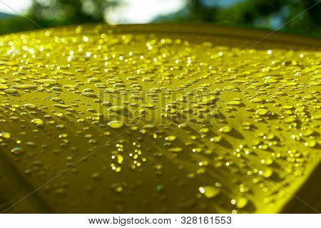 Rain Drops On A Yellow Tourist Tent In The Morning Sun. The Material Is Waterproof.