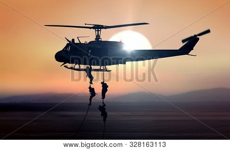 Military Commandos Helicopter Drops At Sunrise During  A Mission