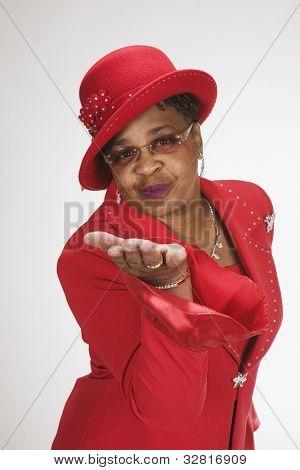 African woman blowing kiss