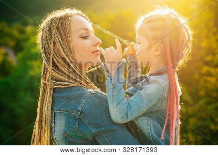 Mother And Daughter With Braiding Hair. Nice Child Girl With Plaits. Hair In Trendy Weave Plait