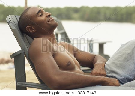 African man sitting in deck chair