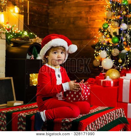 Childhood Memories. Boy Cute Child Cheerful Mood Play Near Christmas Tree. Family Holiday. Merry And