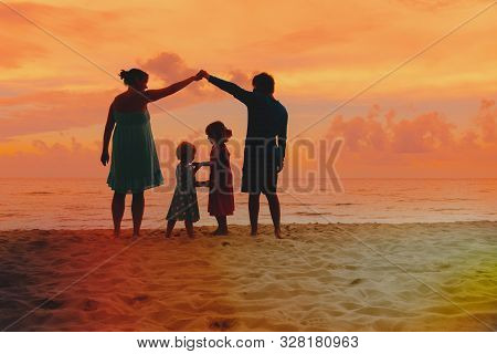Happy Parents Making Home For Kids At Sunset Beach, Family Care