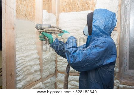 Foam Is Applied To The Walls To Warm The House