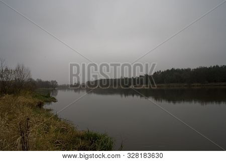 Beautiful Polish Autumn Cold Gray Cloudy November Landscape Of Podlasie With The River Bug