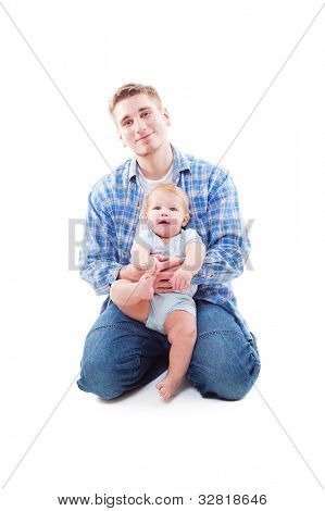 studio shot of father sitting with his son. isolated on white