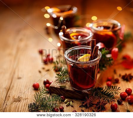 Christmas Mulled Red Wine With Spices And Citrus Fruits On A Wooden Rustic Table, Copy Space. Tradit