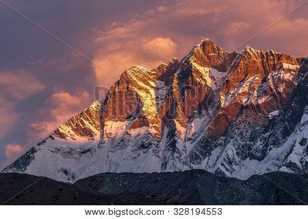 Beautiful Sunset With Pinkish Clouds Over Himalayan Mountains. Glamorous Photo.
