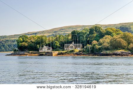 Two Cottages Facing Loch Aline, Close To The Mouth Of The Loch. Loch Aline Is A Small Salt Water Loc