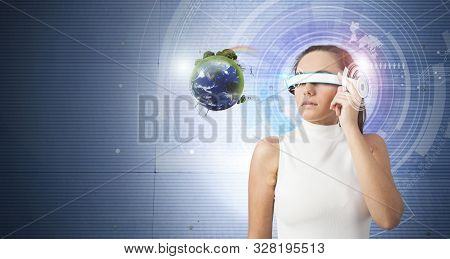 Young Woman With Futuristic Smart Glasses. She Touching Her Smart Glasses  And Looking At Holographi
