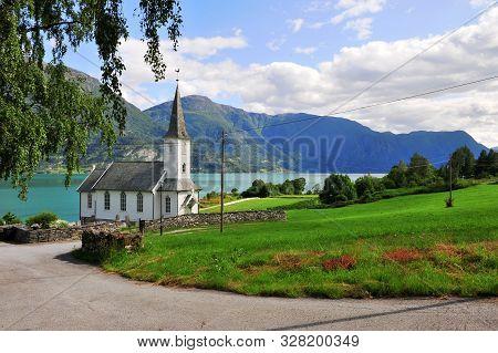 Traditional Scandinavian Church At The Lake