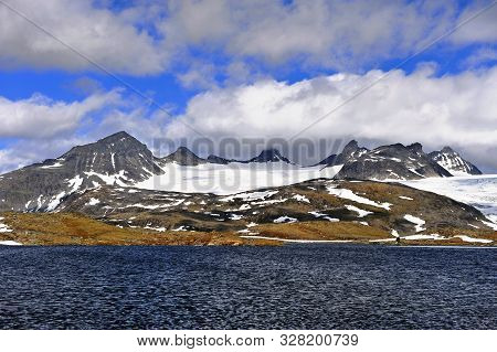 Mountain Peaks Over The Lake Water, Norway