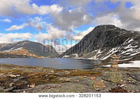 Stone Pyramid And Mountain Lake, Natural Landscape