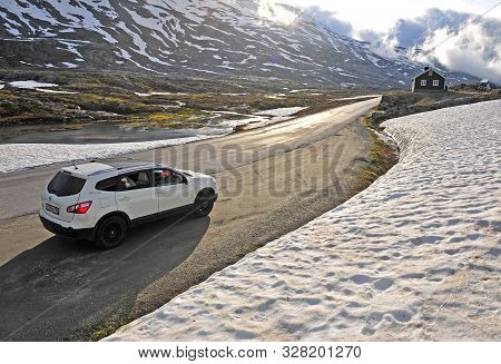 Auto On The Snow Road At Geiranger, Norway