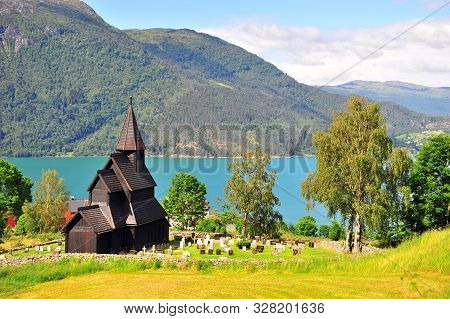Amazing Landscape With Old Wooden Chapel On Fjords
