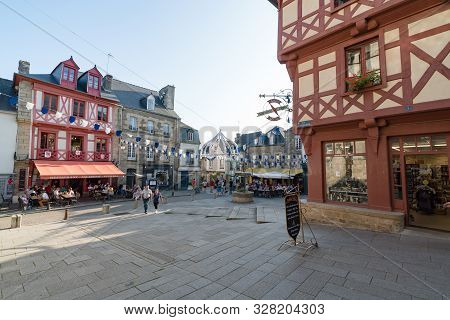 Josselin, Morbihan / France - 26 August 2019: Tourists Dining Out In Restaurants At The Place Notre