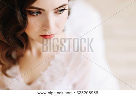 Bride In Elegant Classic Wedding Dress. Morning Of The Bride. Bride In Lingerie. Wedding Preparation