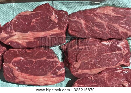 Prime Raw Rib-eye Steak. Raw Beef Steaks.raw Beef Steaks Are Trapped On Paper To Remove Excess Fluid