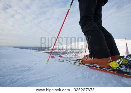 Kirovsk, Russia - Skier On Piste In High Mountains On Ski Slope. Rear View. Winter Snowboard And Ski