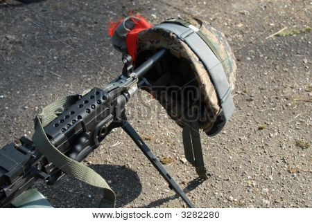 Machine Gun And Helmet