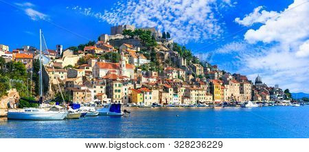 Beautiful places of Croatia - magnifiicent medieval coastal town Sibenik with old castle on the top