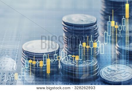 Business Growth Or Financial Concept. Double Exposure Of Candlestick And Stack Of Coins Over Bank Ac