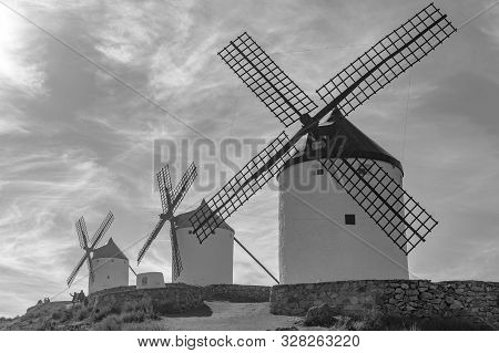 Black And White Photography Of Set Of Windmills Dating Back To The 19th Century On Top Of Cerro Cald
