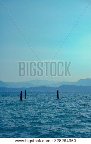 View Over Lago Di Garda On Mountains With Birds