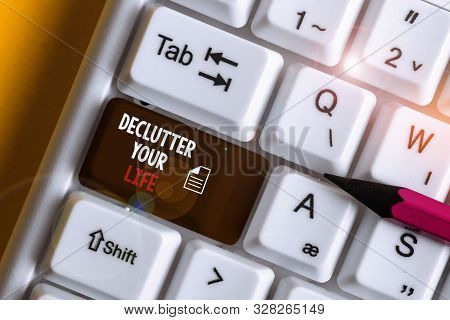 Word writing text De Clutter Your Life. Business concept for remove unnecessary items from untidy or overcrowded places White pc keyboard with empty note paper above white background key copy space. poster