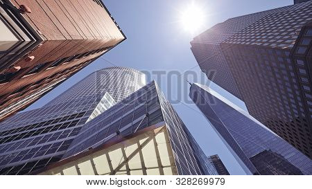 Looking Up At New York Skyscrapers Against The Sun, Color Toned Picture, Usa.