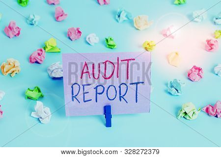 Word writing text Audit Report. Business concept for An appraisal of complete financial status of a business Assets Colored crumpled papers empty reminder blue floor background clothespin. poster
