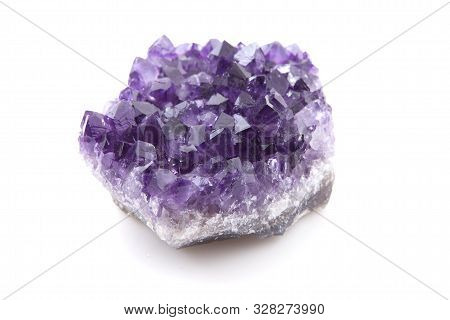 One Purple Amethyst Gemstone Over White Background