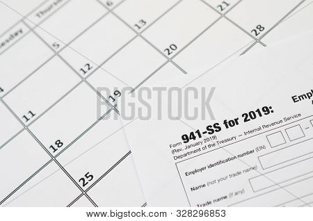 Irs Form 941-ss Employers Quarterly Federal Tax Return Blank Lies On Empty Calendar Page
